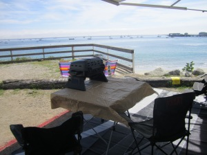 Beach camping in a delivered RV Rental, set up and ready for check-in